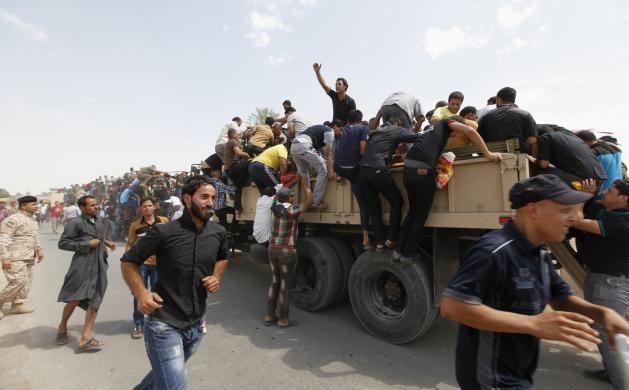 تصاویر عکاس رویترز از هجوم داوطلبان عراقی برای مبارزه با داعش
