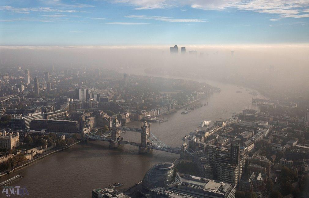 عکس | نمای هوایی زیبا از پل برج و اسکله قناری لندن در میان مه