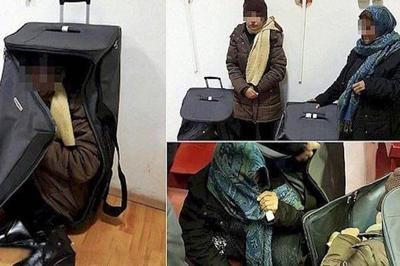 عکس   بازداشت دو زن پنهان شده در چمدان