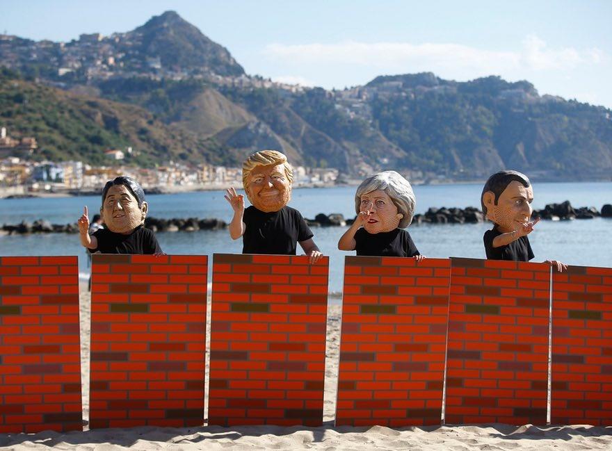 عکس   ماسک سران کشورهای گروه ۷ بر صورت معترضان ایتالیایی