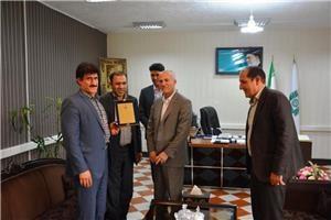 تجلیل از آزاده و جانباز اداره  امور مالیاتی استان لرستان