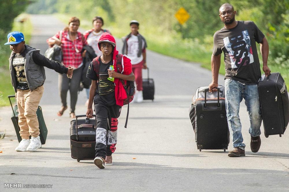 تصاویر | فرار مهاجران از آمریکا با پای پیاده